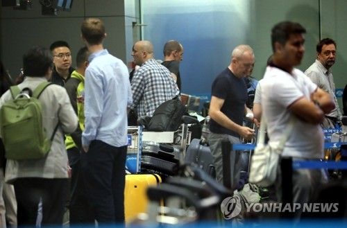 Foreign reporters wait before departure to North Korea at the Beijing Capital International Airport on May 22nd, 2018.