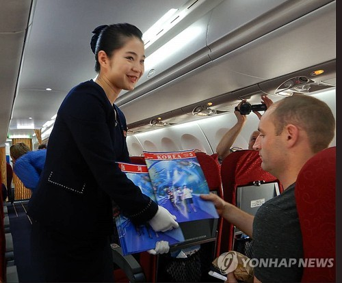 Foreign journalists fly to North Korea on a Air Koryo plane