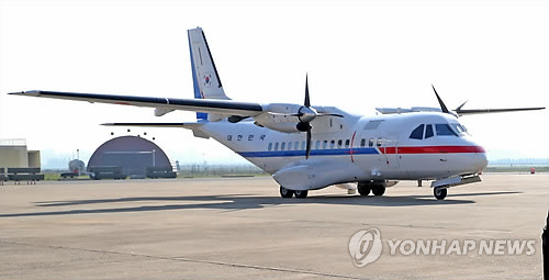 a government transport plane to carry South Korean journalists to North Korea