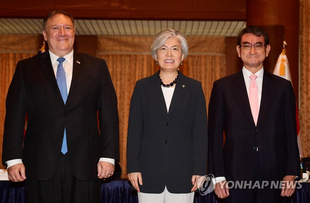 U.S. Secretary of State Mike Pompeo (L), Foreign Minister Kang Kyung-wha (C) and Japanese Foreign Minister Taro Kono