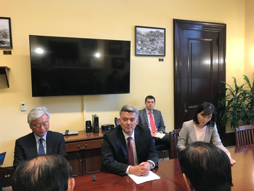 South Korean lawmakers meet with Sen. Cory Gardner (C) on Capitol Hill in Washington on July 18, 2018.