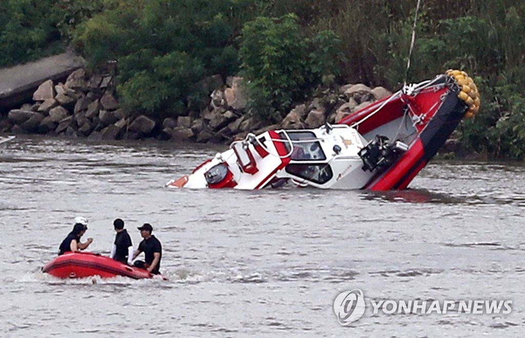 Fireboat sinks during rescue mission along Han River.