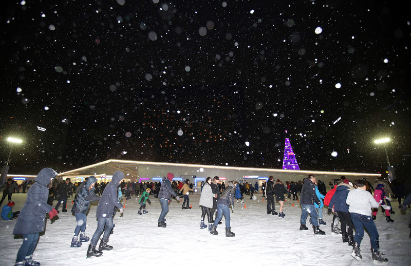 People skating in the snow