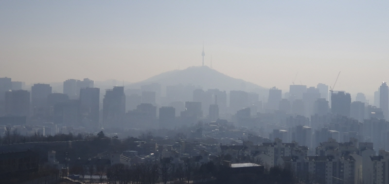 a city skyline covered in fine dust