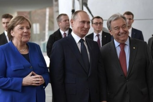 German Chancellor Angela Merkel (L) Russian President Vladimir Putin, and U.N. Secretary-General Ant?nio Guterres (R)