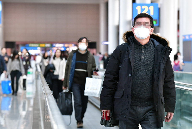 people wearing face masks against the new fast-spreading coronavirus
