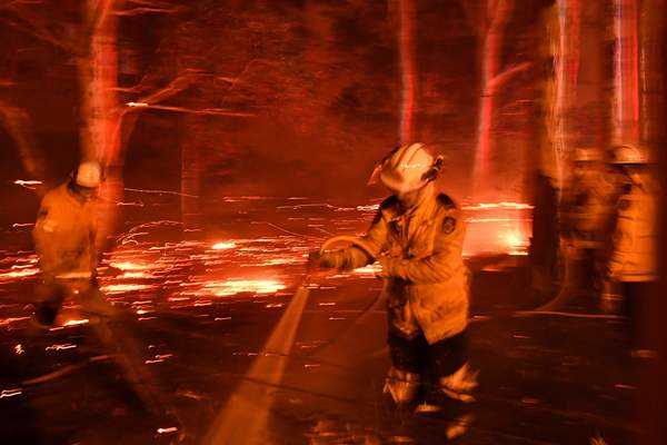 Firefighters work to contain bushfires in New South Wales, Australia