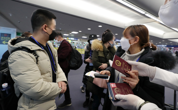 Travelers from China will have to download mobile application to report health status while in South Korea