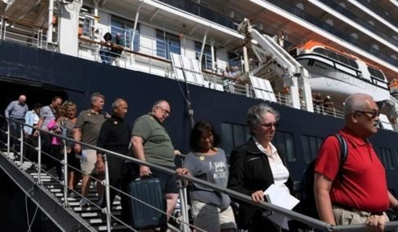Passengers are getting off the Westerdam cruise ship in Cambodia.