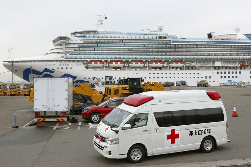 An ambulance is leaving the Yokohama port where the Diamond Princess cruise ship is docked.