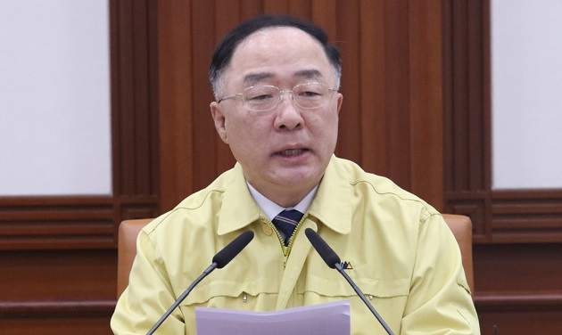 Finance Minister Hong Nam-ki speaks at a meeting with economy-related ministers.
