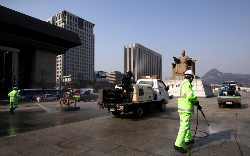 Gwanghwamun Square in central Seoul being disinfected