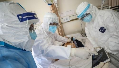 Doctors checking a lung image of COVID-19 virus patient in Wuhan Red Cross Hospital