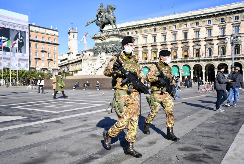 Italian military personnel patrol Milan wearing masks