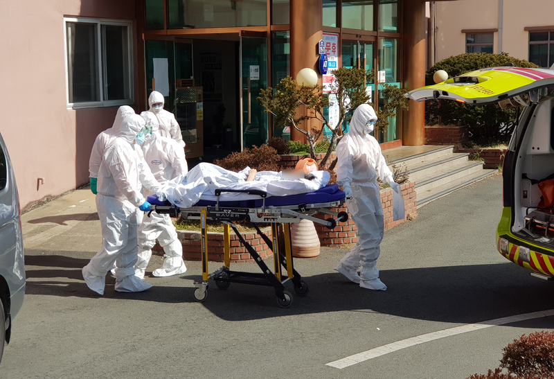 a coronavirus patient being transported to a hospital