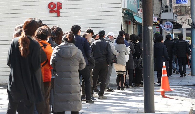 People waiting to buy face masks