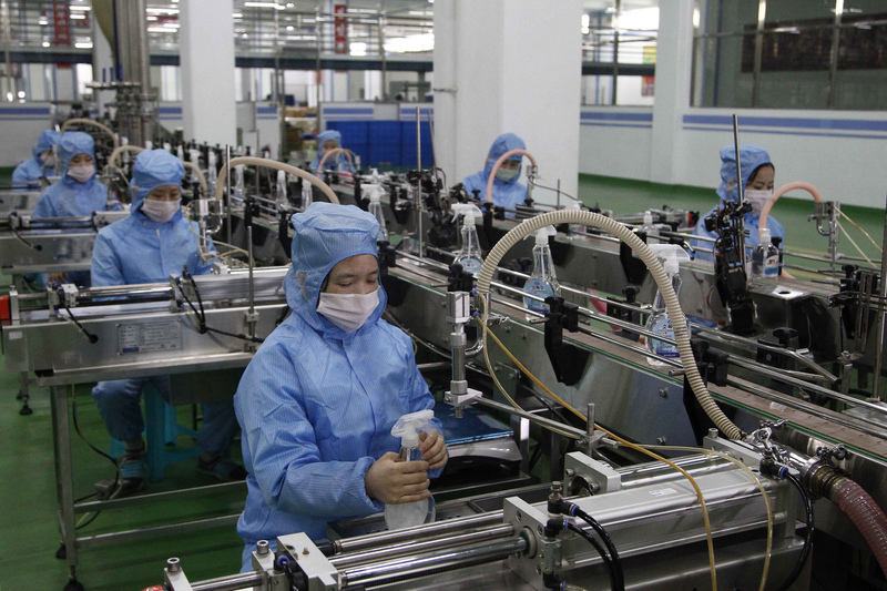 Ryongaksan Soap Factory workers make disinfectants in Pyongyang, North Korea.