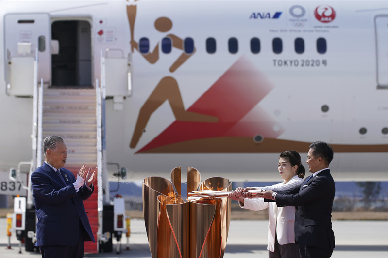 The Olympic flame arrives in Japan.