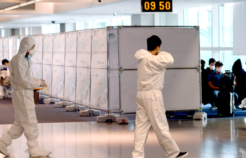airport officials are setting up open walking-thru COVID-19 testing facilities for people arriving at the Incheon International Airport