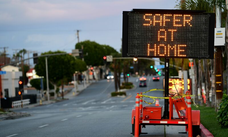 A roadside sign in Monterey, California advises residents to stay at home