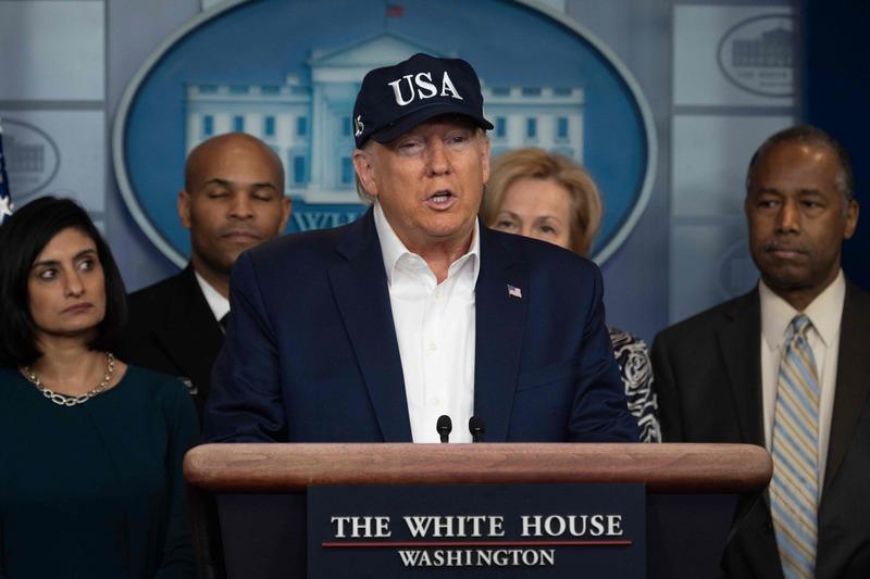 U.S. President Donald Trump (C) holds a presser on COVID-19.