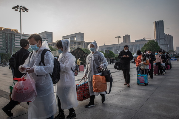 Passengers wait to enter a railway station after lockdown was lifted in Wuhan, China, April 8.