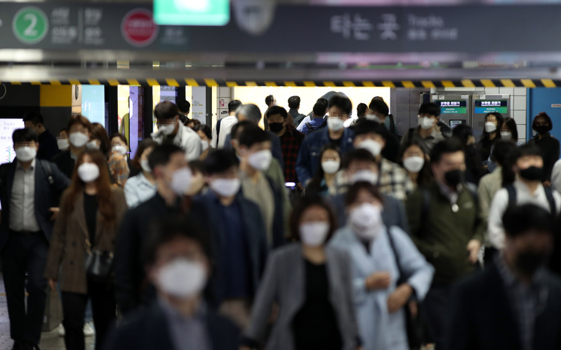 Commuters pass through Gangnam Station in southern Seoul.