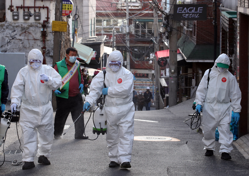 Officials disinfect the Itaewon area.