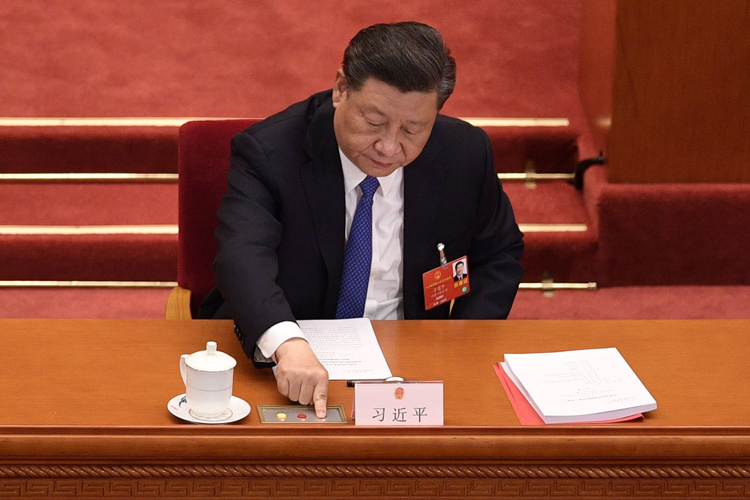 Chinese President Xi Jinping votes on a new draft security bill for Hong Kong at the Great Hall of the People in Beijing, China on May 28, 2020.
