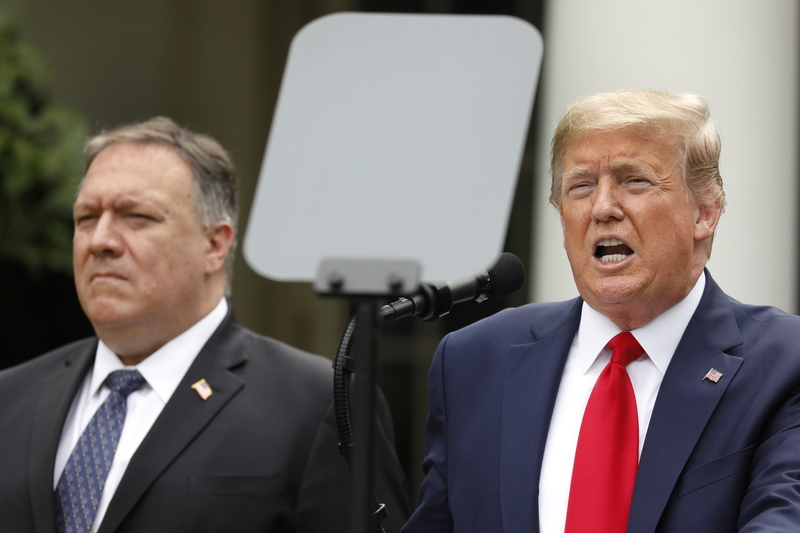 U.S. Secretary of State Mike Pompeo (L) standing beside U.S. President Donald Trump