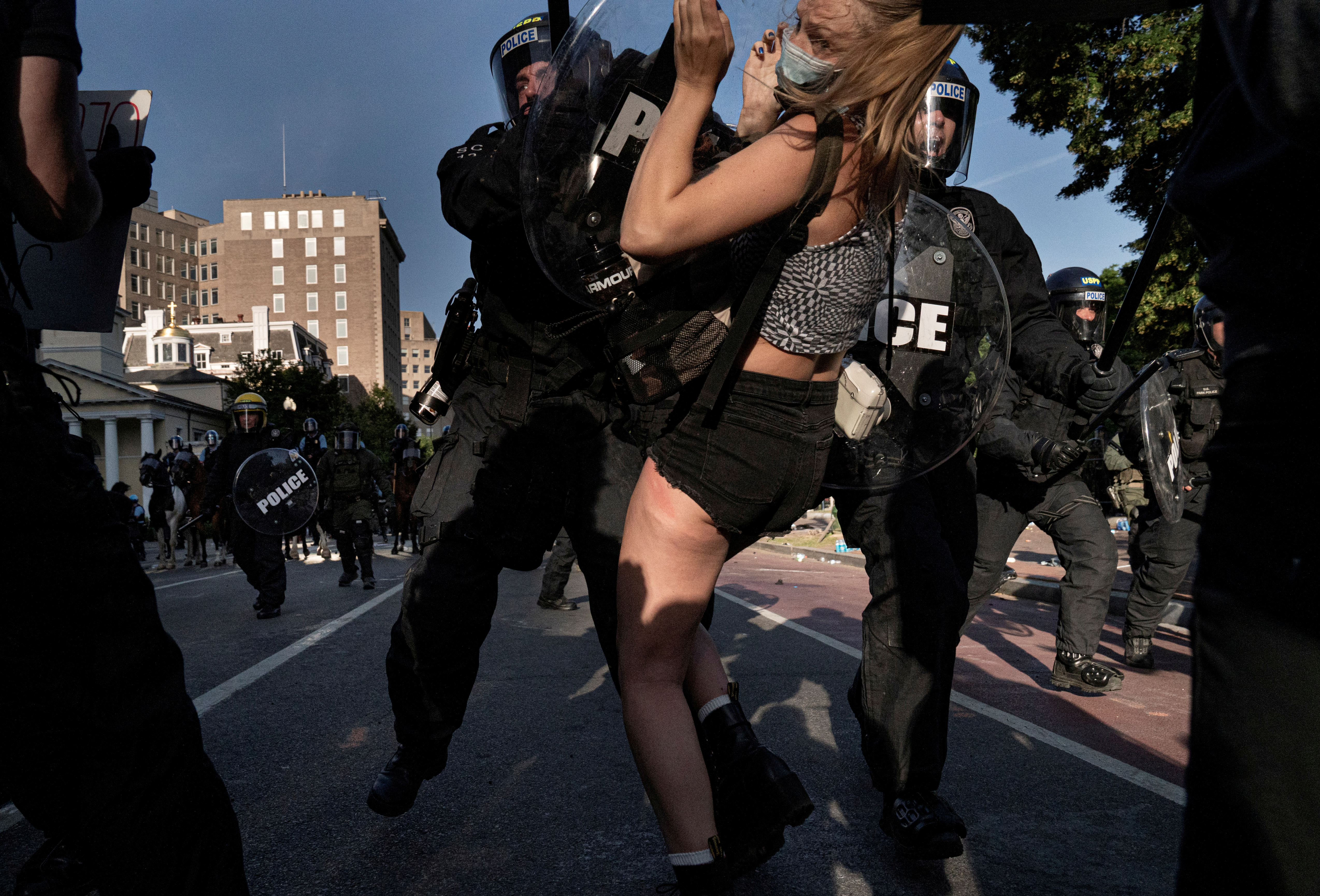 Riot police rush demonstrators as they clear Lafayette Park near the White House in Washington, D.C.
