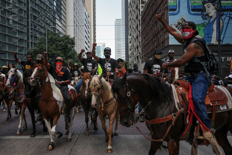 Protestors on horses in Houston, Texas Tuesday
