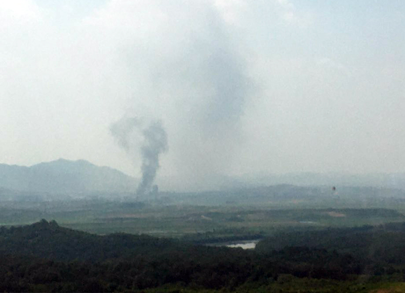 Smoke billows from the joint inter-Korean liaison office in the border town of Kaesong on Tuesday.