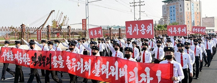 North Korean students hold a march in protest against anti-Pyongyang leaflets sent from South Korea.