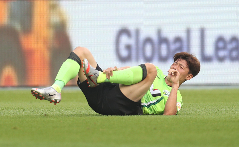 Jeonbuk Hyundai Motors midfielder Kim Bo-kyung clutches his left ankle after a violent tackle during play against Ulsan Hyundai FC on June 28, 2020.