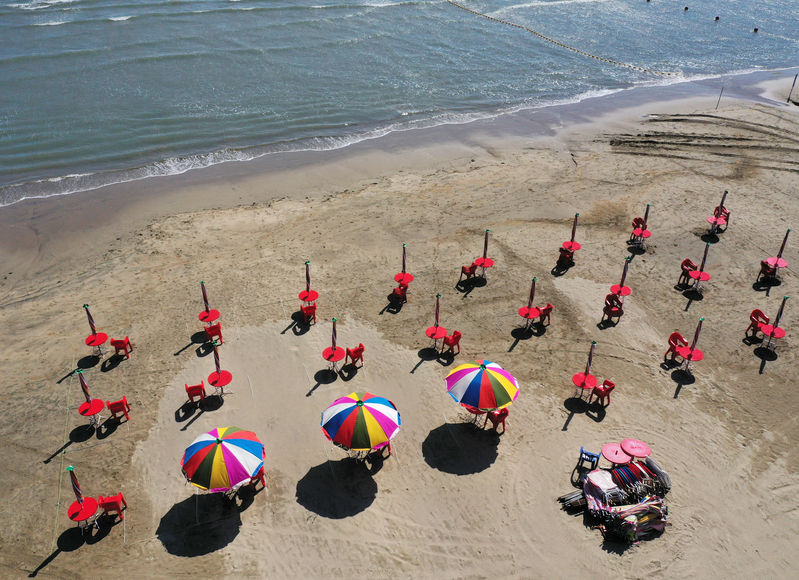 Umbrellas are spread out for visitors at Busan's Dadaepo Beach.