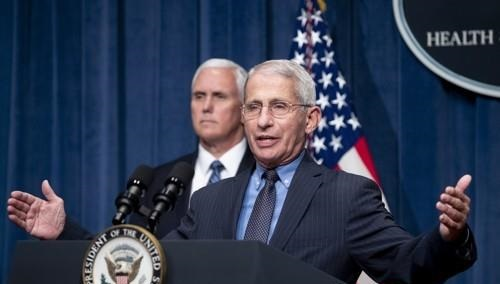 Dr. Anthony Fauci (R), the top U.S. infectious disease expert, and Vice President Mike Pence