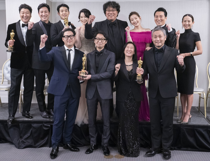 The cast and crew of 'Parasite' pose with their Oscars at the 92nd Academy Awards.