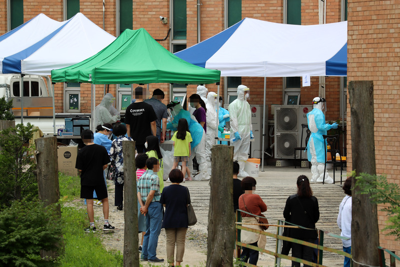 Residents in the city of Daegu line up at a testing center outside a church after a member was diagnosed with COVID-19.