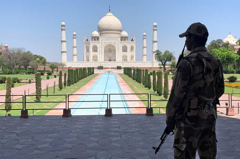 Security personnel stands guard inside the empty premises of the Taj Mahal during a 21-day lockdown in India to slow the spread of COVID-19.