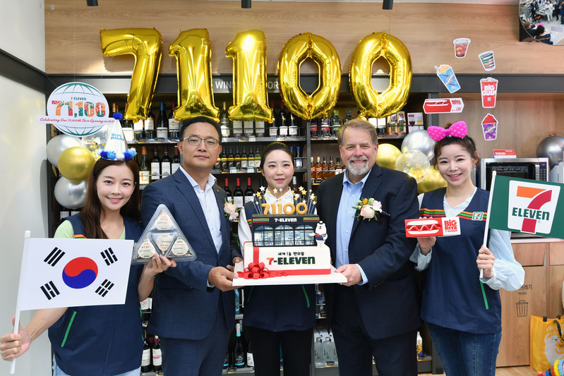 7-Eleven Korea officials pose for a photo at the 71,100th store in Seoul's Bangbae-dong on July 9, 2020.