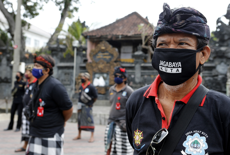 Security guards prepare for the reopening of Kuta Beach in Bali, Indonesia after a three-month virus lockdown.
