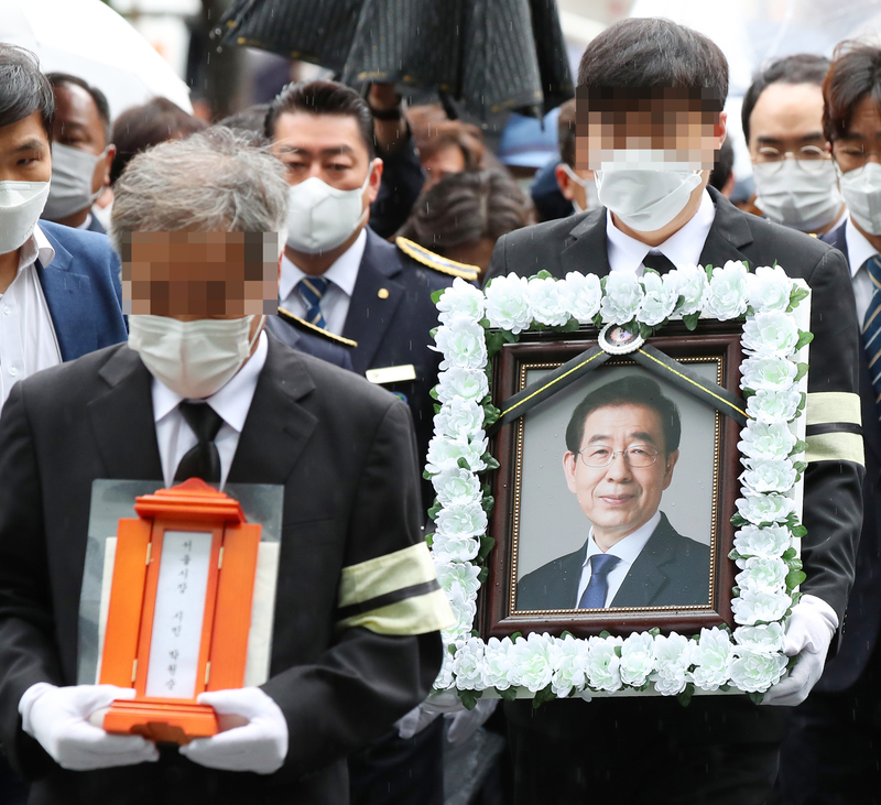 Mourners carry the mortuary tablet and portrait of late Mayor Park Won-soon during a funeral procession on July 13, 2020.