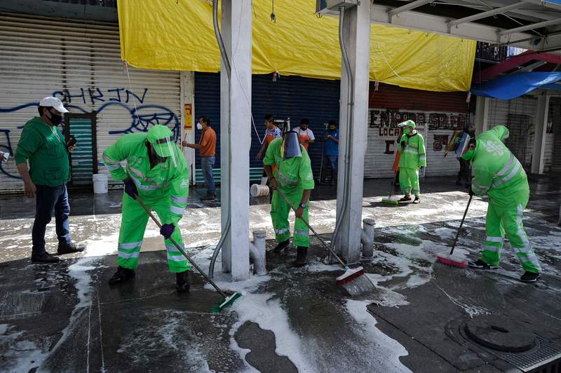 Municipal workers clean and disinfect a sidewalk in the neighborhood of Tepito in Mexico City amid the novel coronavirus pandemic.