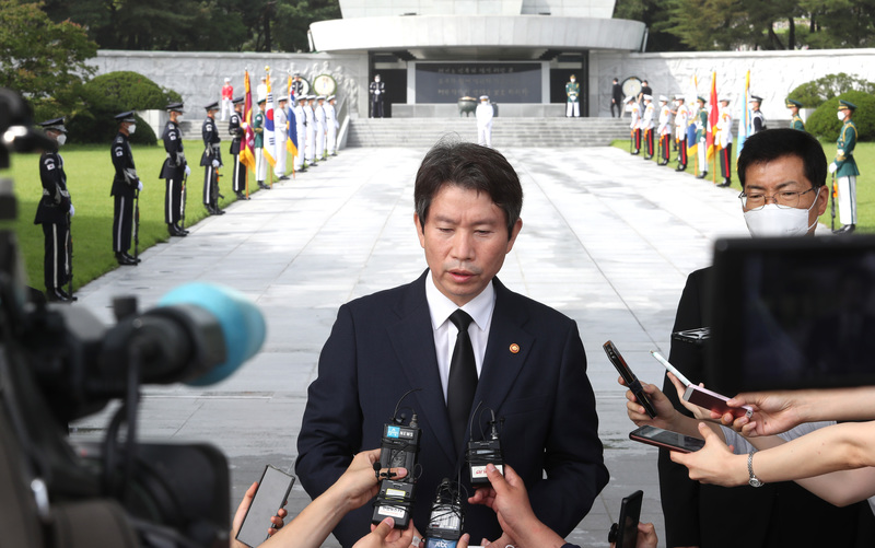Unification Minister Lee In-young speaks to reporters at the National Cemetery in Seoul on July 30, 2020.