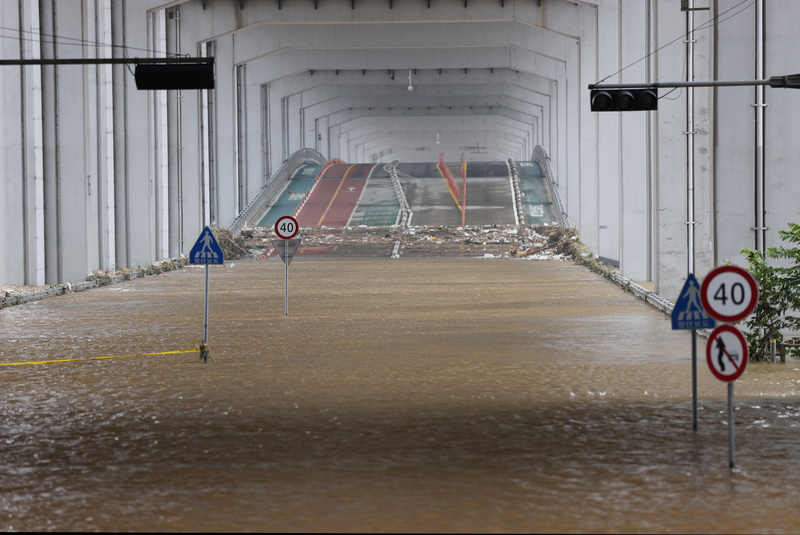 The Jamsu Bridge remains submerged and closed off to cars and pedestrians due to high water levels on the Han River following days of heavy rain.