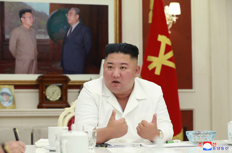 In this photo released by the , in this photo released by the Korean Central News Agency, North Korean leader Kim Jong-un speaks during an executive policy council meeting of the Worker's Party on August 5, 2020.