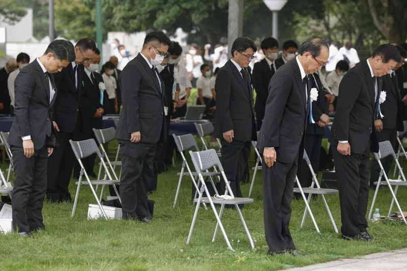 Attendees of a ceremony held on Thursday to mark 75 years since the Hiroshima atomic bombing offer silent prayers to the victims.