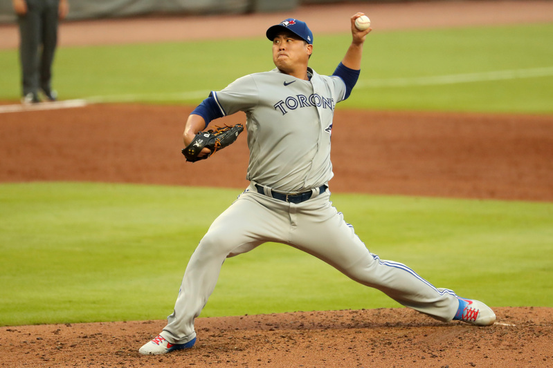 Toronto Blue Jays starting pitcher Ryu Hyun-jin delivers a pitch to an Atlanta Braves batter at Truist Park in Atlanta, Georgia, on August 5, 2020.