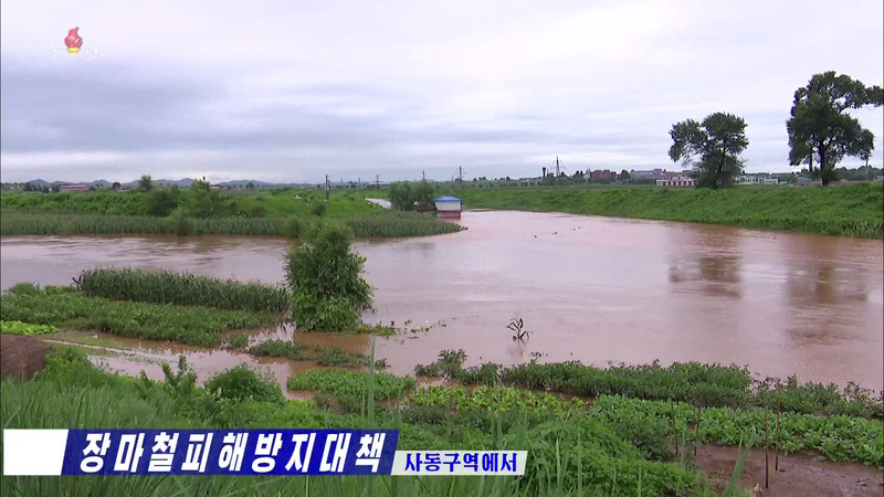 Farmland in eastern Pyongyang is flooded after heavy rains, in this photo captured from North Korea's Korean Central Television on August 6, 2020.